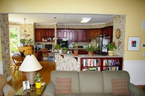 Before picture showing outdated kitchen cabinets, design and countertop)
