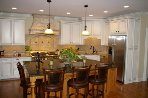This pictures shows a newly remodeled kitchen with slate, granite and a neutral palette to give it a timely elegant look