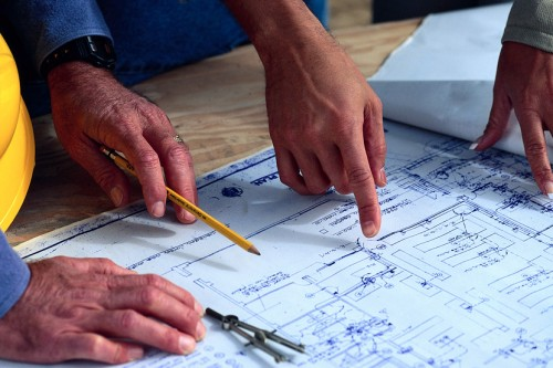 New home builder working with homeowner on the home design and architecture