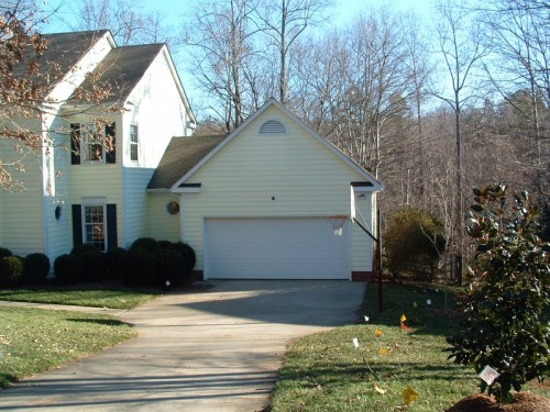 Picture of home before addition was made above the garage