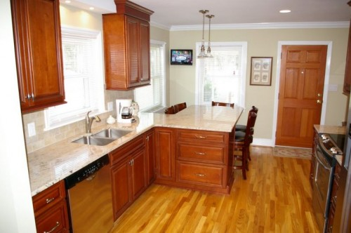 New kitchen after remodel with view of updated cabinets, appliances and new granite countertop