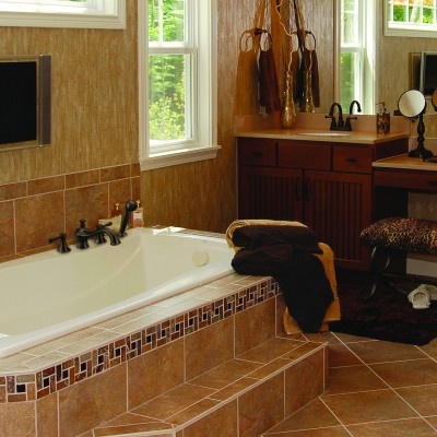 Bathroom renovation with new tub, tile, sink faucet and other updated bathroom appliances