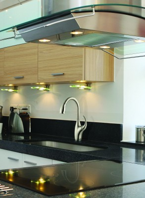 Luxury modern kitchen interior with brushed nickel sink faucet