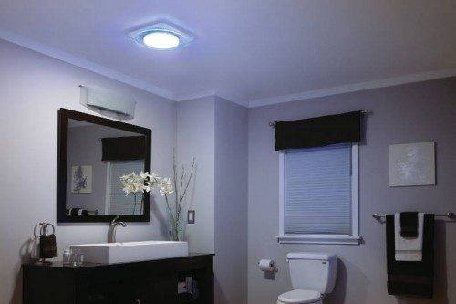 Updated bathroom light fixtures give this renovated bathroom better visibility for a much better experience
