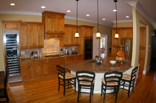 Newly remodeled kitchen with LED lights strategically placed to illuminate the elegant fixtures, appliances and trimming