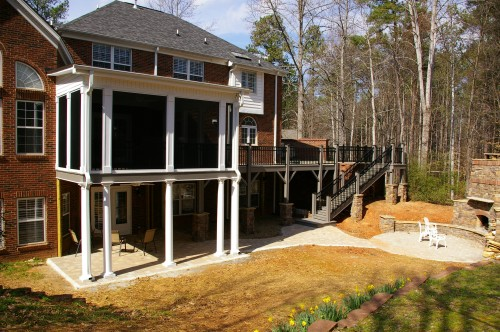 Extensive home addition pictures: screened porch, deck, grilling terrace and fireplace with sitting area