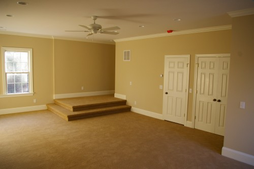 New room after the unfinished attic space above the garage was transformed into new family room
