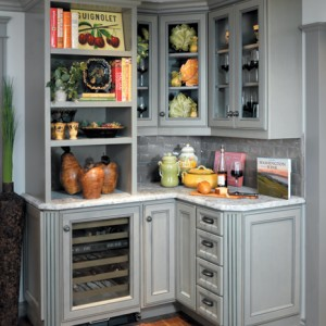 This kitchen countertop and wine drawer uses the gray neutral tones to juxtapose against rich touches of bright color