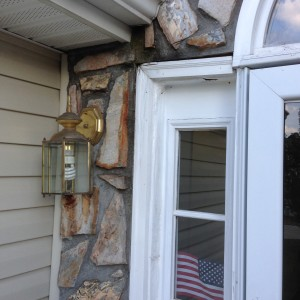 Closeup photo of door Frame damage from lack of roof flashing in Stone Veneer in Charlotte, NC