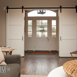 Interior sliding barn doors used to help flow traffic through front door