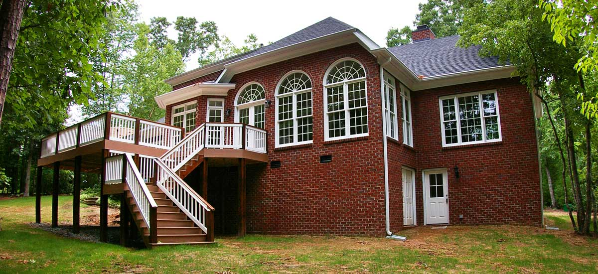 Home addition contractor's photo of a major home remodel, home addition, new porch and elevated deck