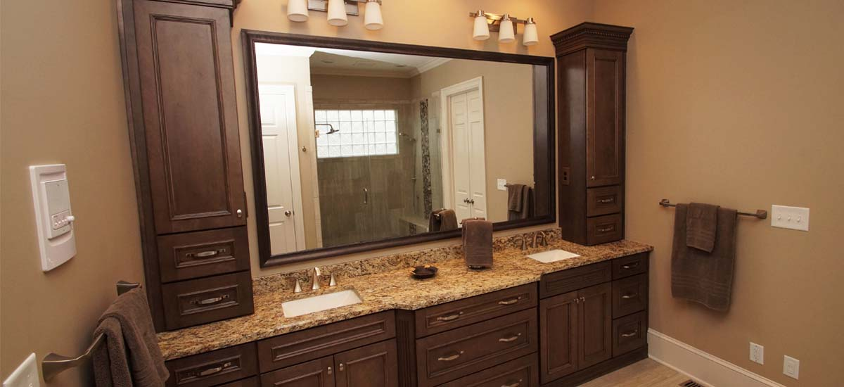 Newly remodeled bathroom with oak framing cabinets, granite vanity with he and she sinks