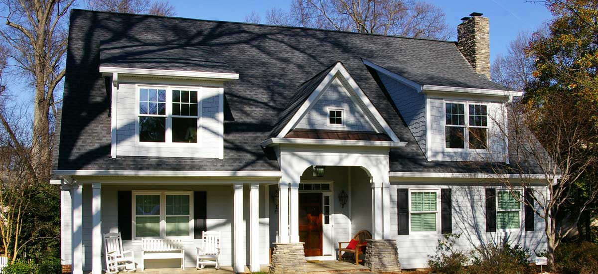 Home remodeling – front facing photo of newly remodeled home with second floor home addition