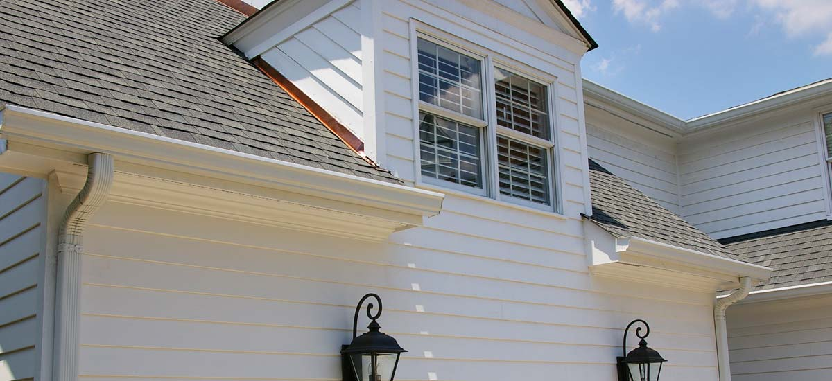 Home repairs in Charlotte showing a repaired dormer with proper flashing
