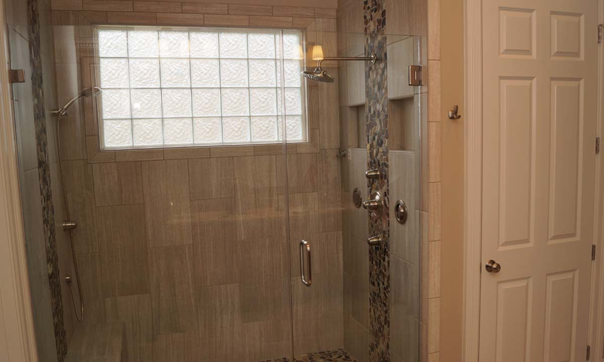 New custom tile walk-in shower, part of a bathroom remodeling project done for client in Charlotte, NC