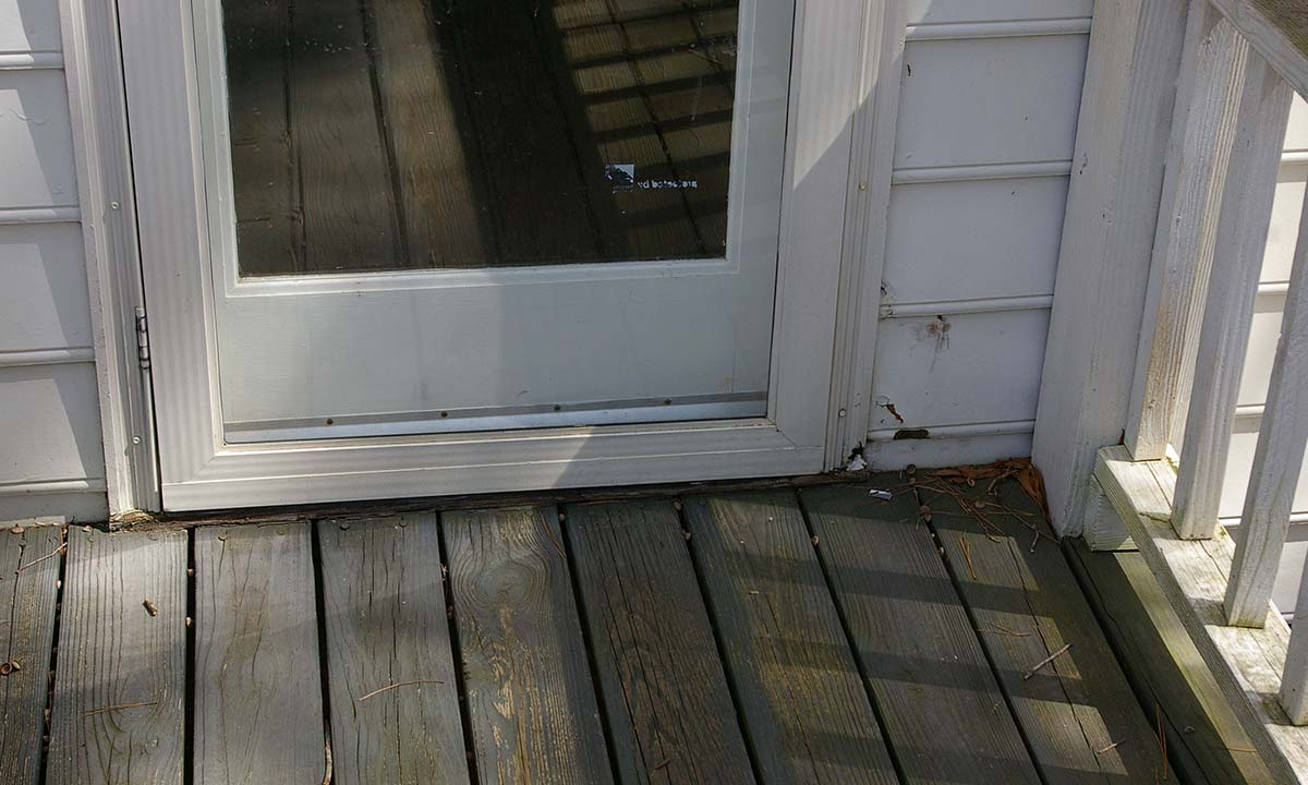 Door frame damage before repair