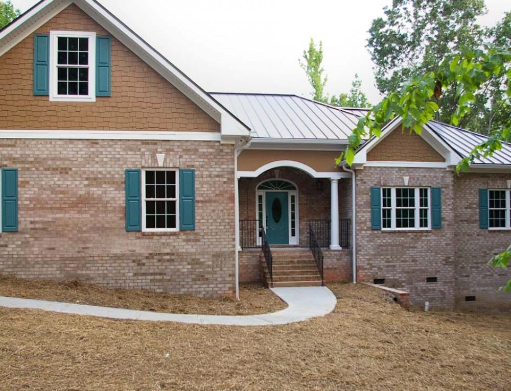 Tuscan country manor custom homes palmer custom builders for Custom brick homes