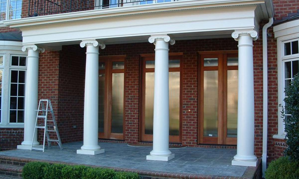 New streamlined front columns replacing a traditional brick exterior