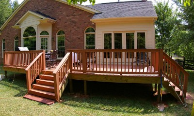 New sunroom and deck after covered porch conversion