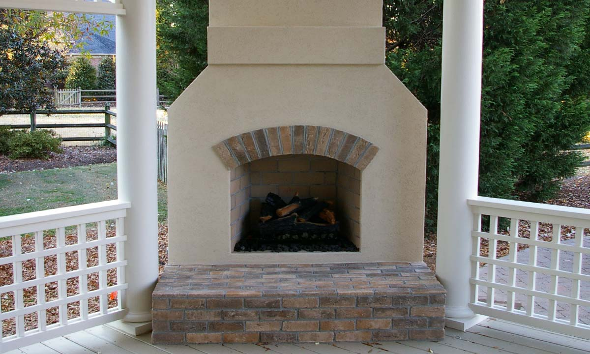 View of outdoor fireplace after covered porch construction