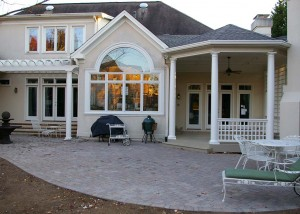 New covered porch and pergola and concrete paver patio to tie the outdoor living area together