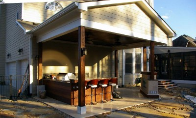 Completed outdoor porch with bar, grill and fireplace