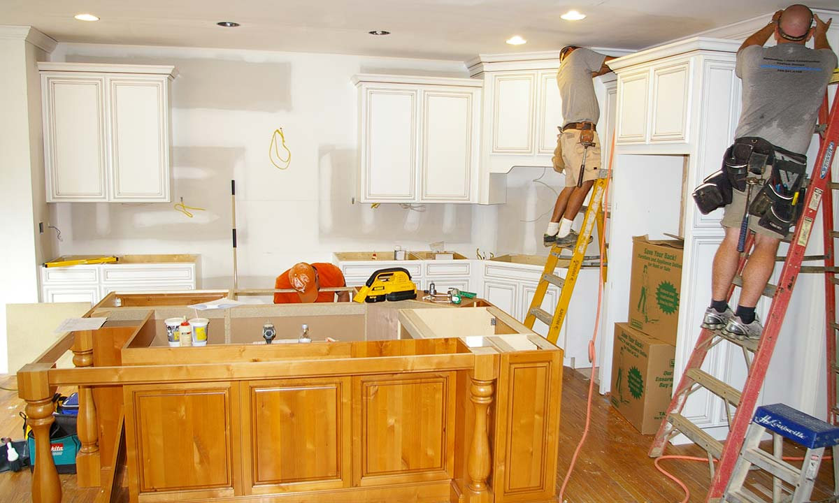 Photo of custom kitchen island and cabinets being built and installed