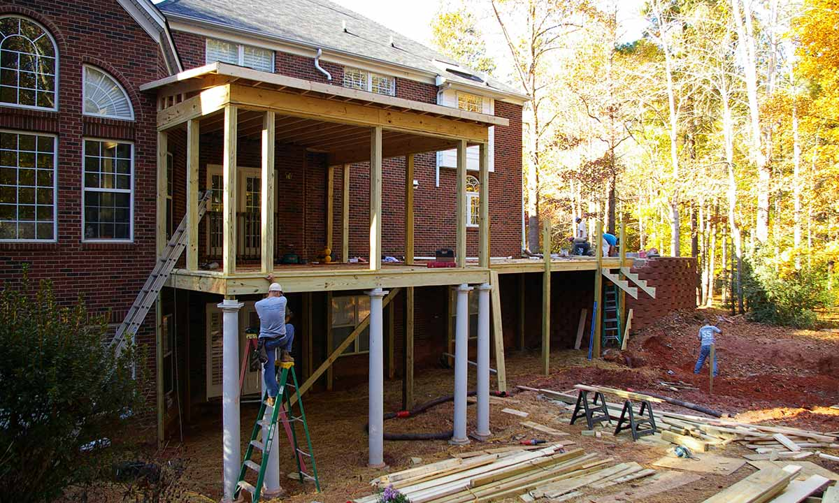 Construction of screened porch addition and deck renovation