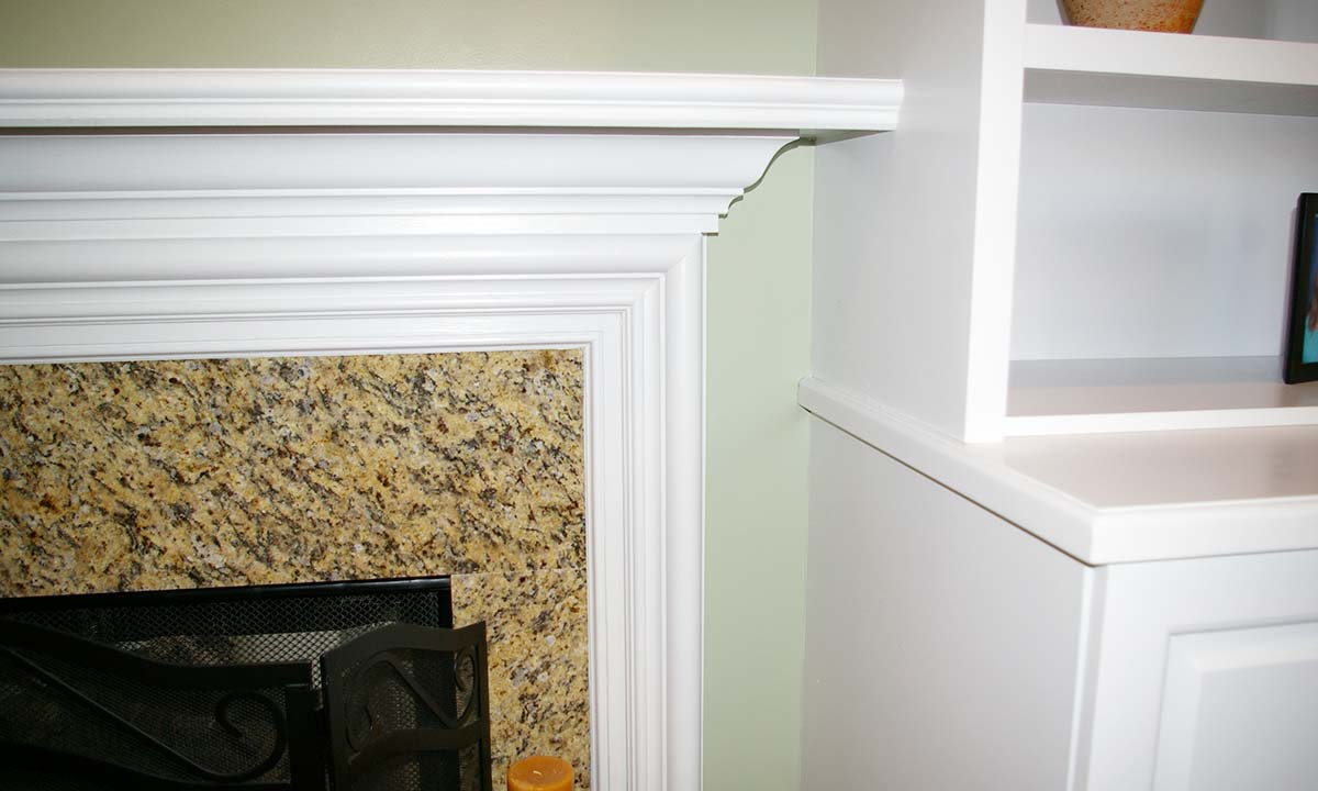 Custom trim mantel around the fireplace adds to the aesthetics of the room