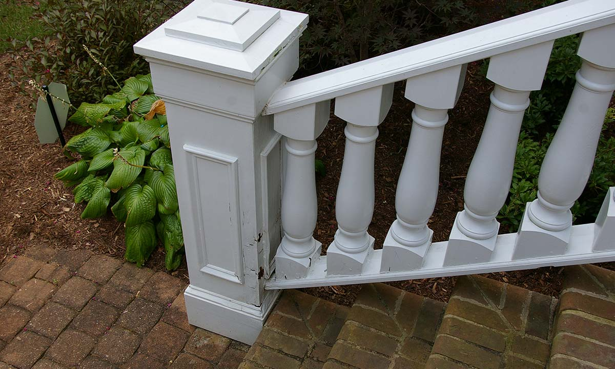 Front porch railing damage before repair