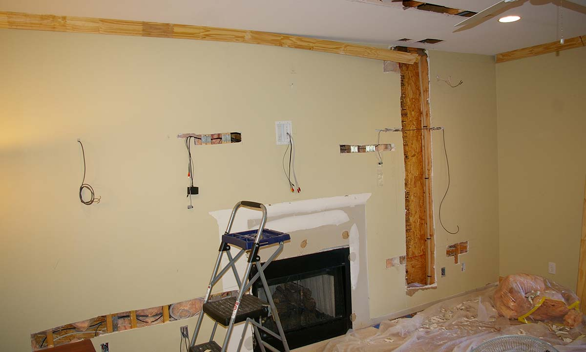During renovation showing old fireplace being removed