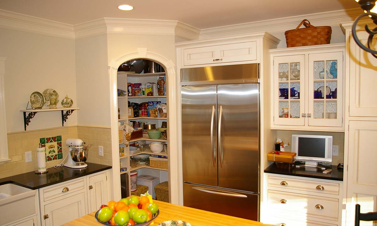 After kitchen remodel with view of pantry and refrigerator