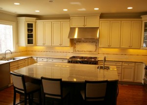 "Kitchen remodeling ""after"" photos show reconfigured wall and layout"