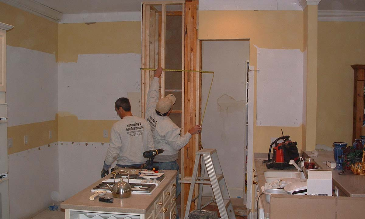 Construction photo of workers creating an enlarged pantry