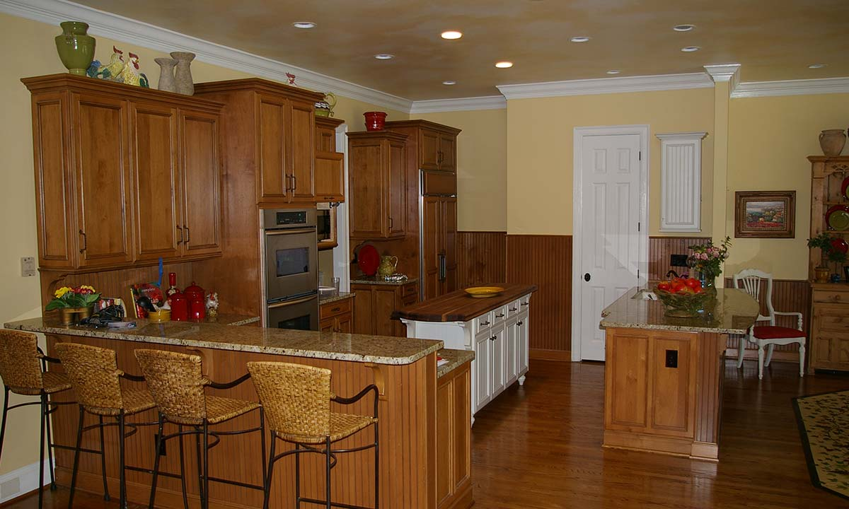 "Kitchen remodel ""after"" the makeover shows improved working and entertaining areas"
