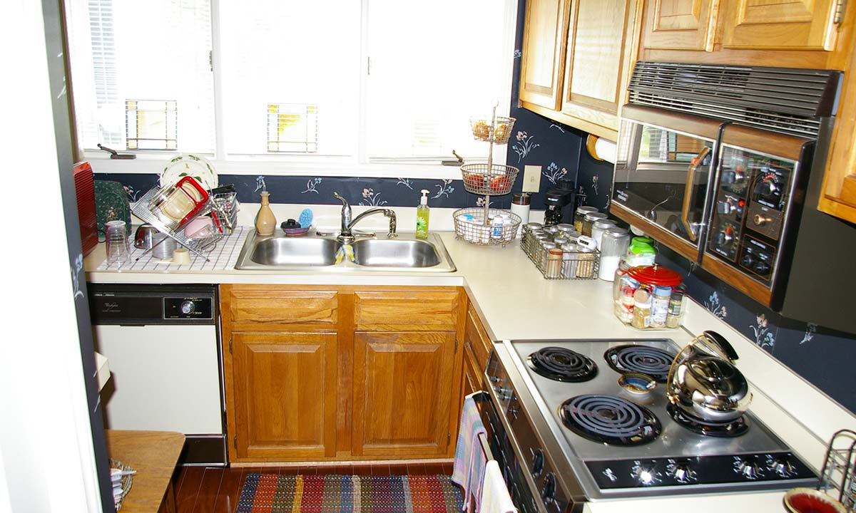 """Before"" kitchen remodel picture of a small Charlotte condo's kitchen"