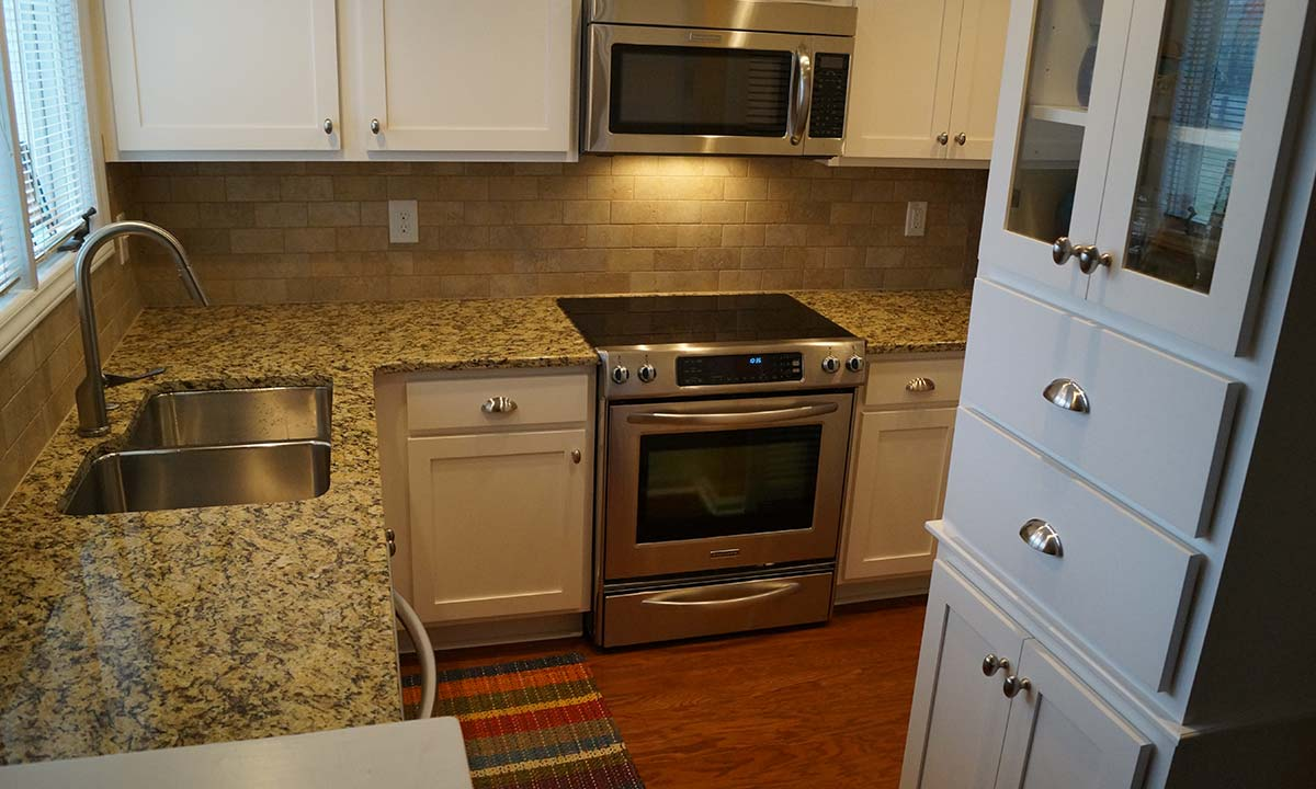 """After"" photo of condo kitchen remodel with space saving layout"