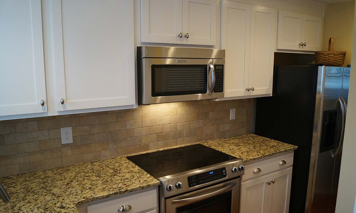View of new granite tops and modern kitchen appliances