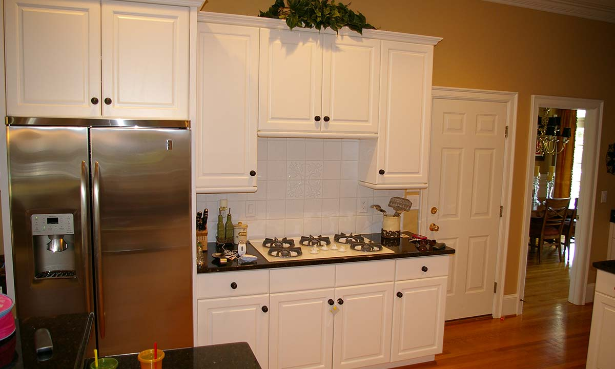 "Another ""before"" kitchen remodel photo showing substandard cabinet work"