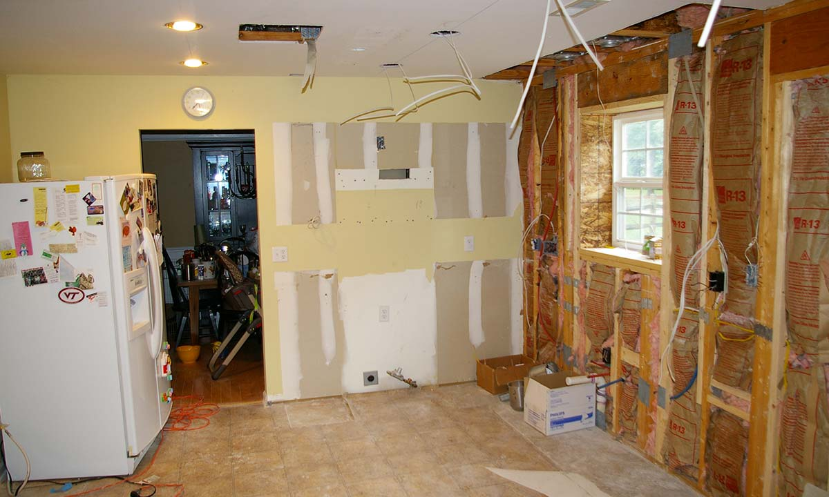 Photo showing stripped kitchen during construction