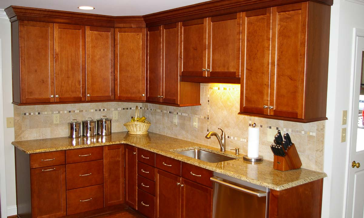 """""""After"""" picture of kitchen renovation with view of sink and cabinets"""