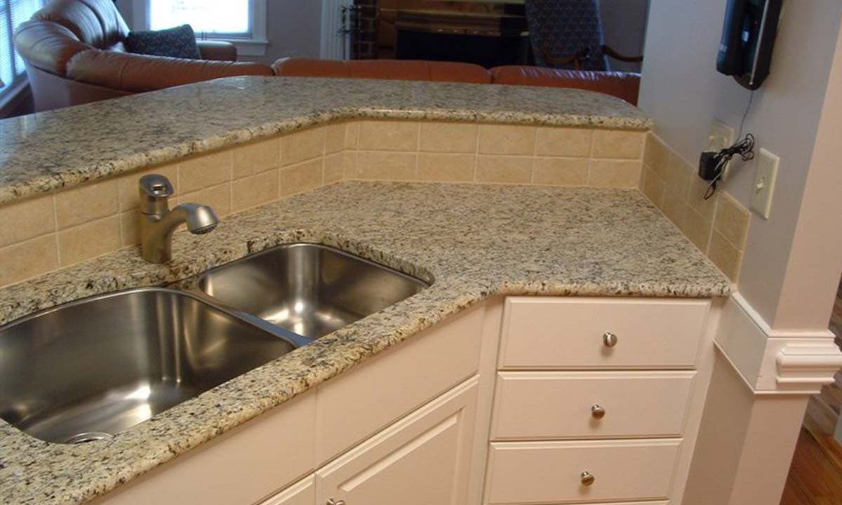 New granite countertops and kitchen sink after kitchen renovation