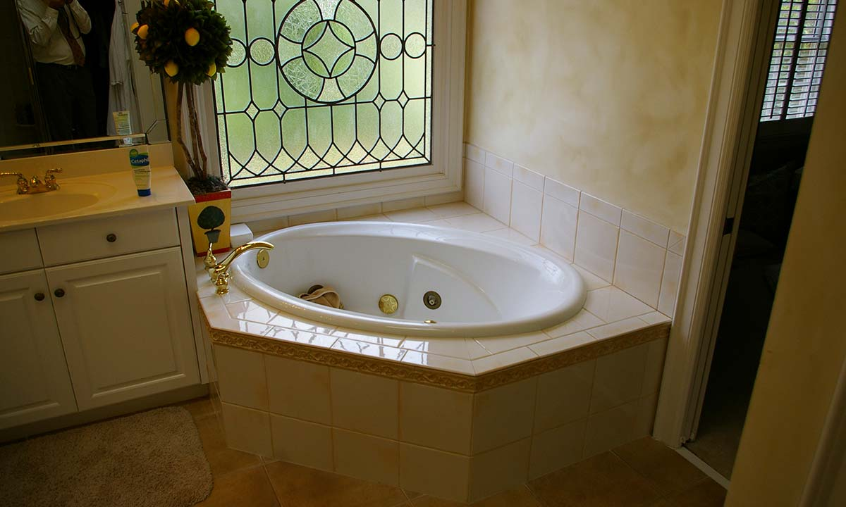 Before the remodel with view of old tub