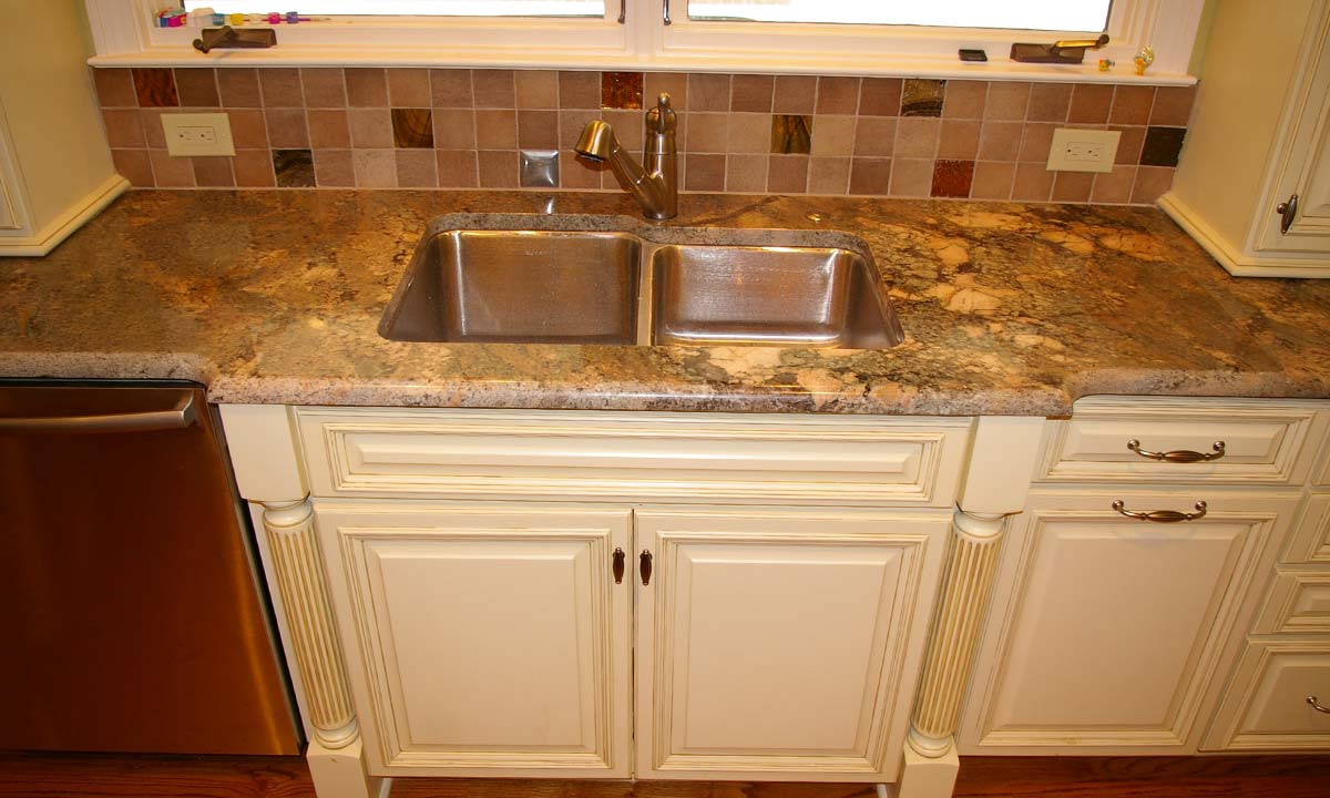 Photo of the new sink with granite countertops that help complete this kitchen remodeling project