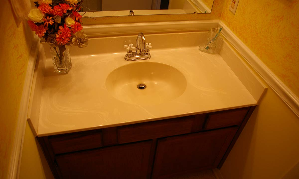Dated powder room sink and countertop made space look smaller