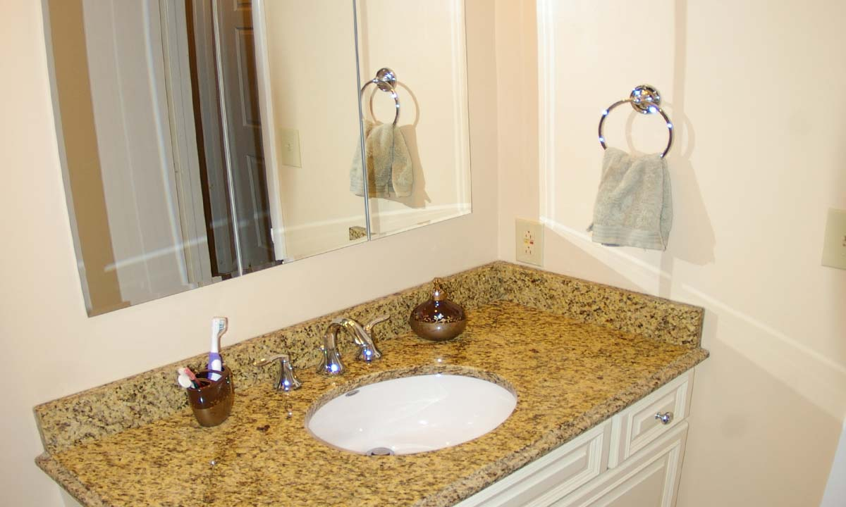 Granite countertop in powder room increased usability and beauty