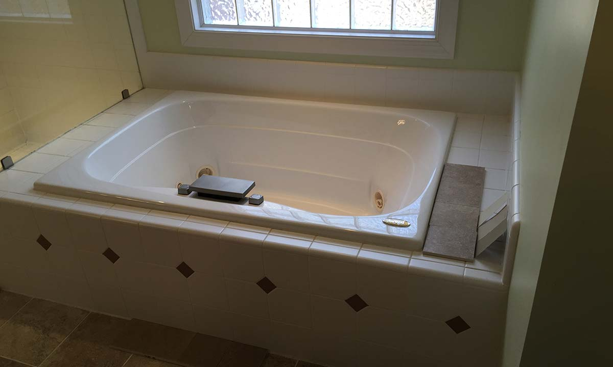 Master bathroom before picture with view of tub