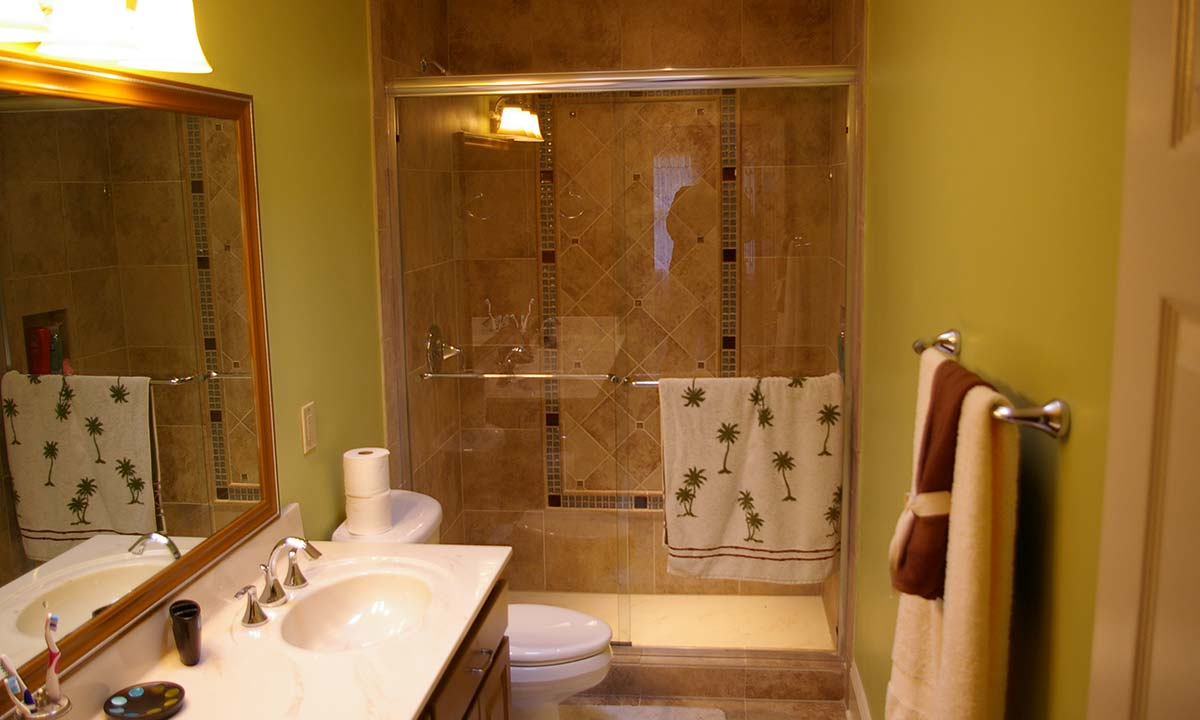 Finished bathroom remodel with new tiled shower