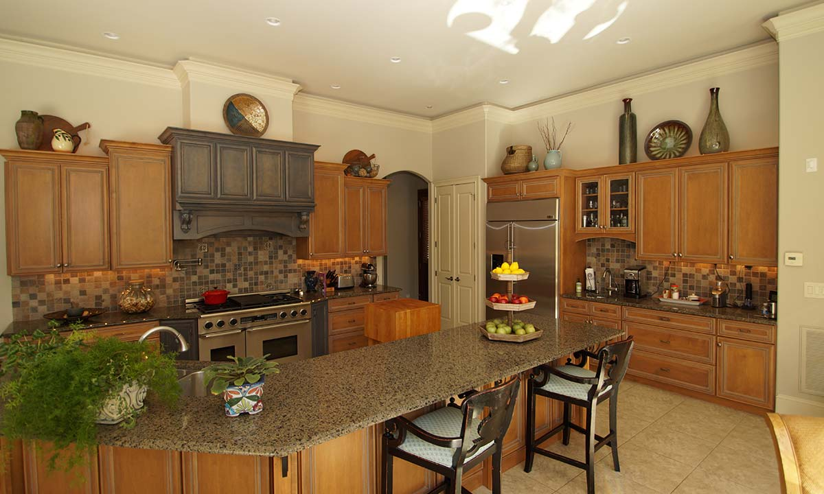 After picture of Mediterranean style home's kitchen