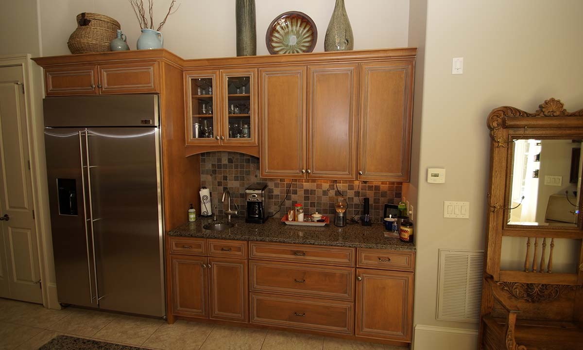 Wet bar and refrigerator picture after kitchen remodel